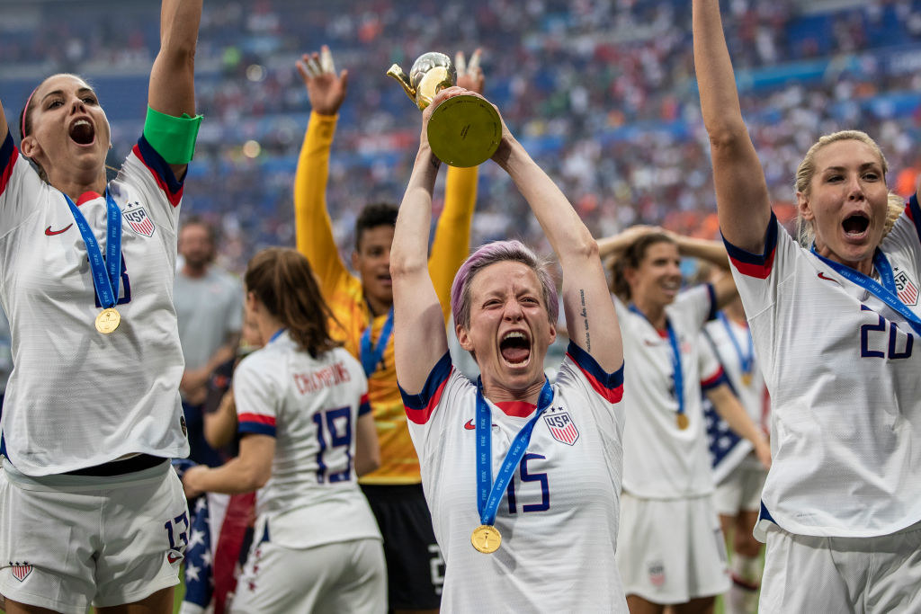 Megan Rapinoe of the USA celebrates with the FIFA Women's World Cup Trophy following her team's victory in the 2019 FIFA Women's World Cup France Final match