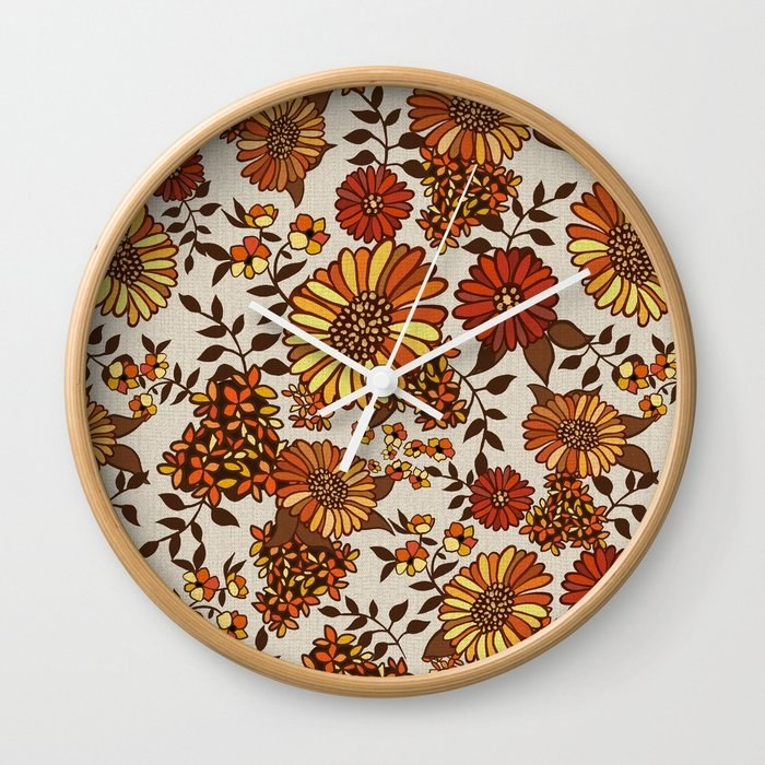 a clock with a floral background