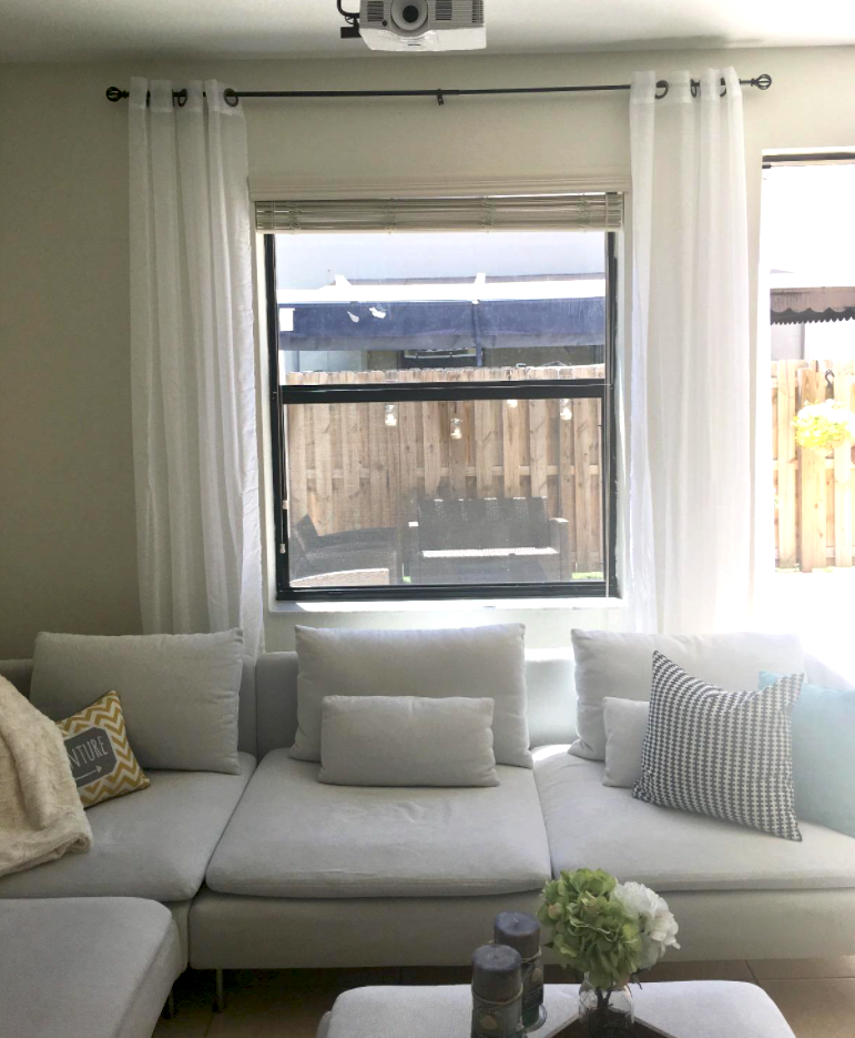 reviewer's living room with white sheer curtains hanging on windows