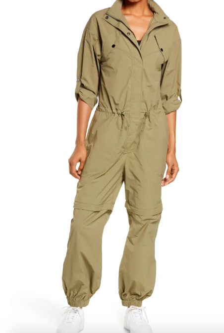 A model wearing the jumpsuit in moss green