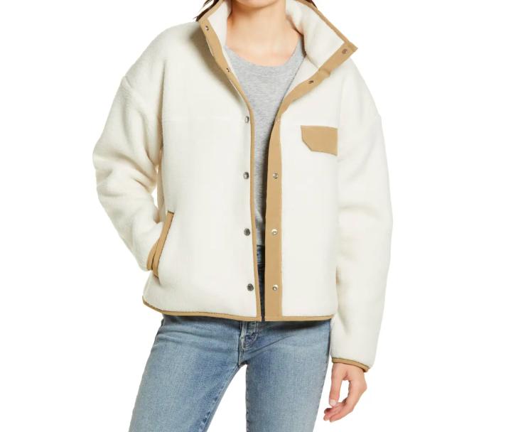 A model wearing the fleece jacket in vintage white
