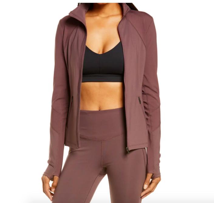 A model wearing the Zella Studio Lite jacket in burgundy