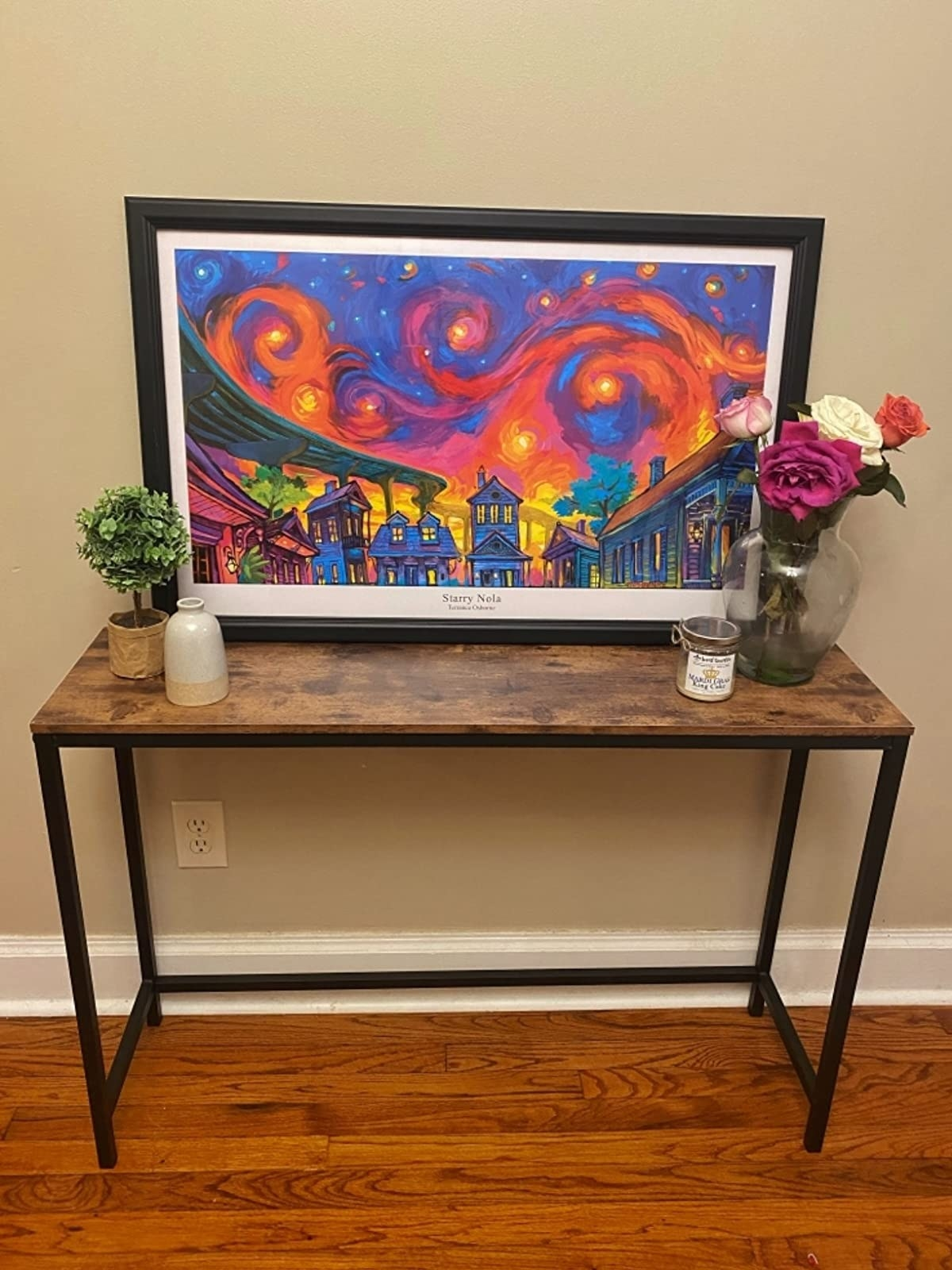 The table with a black metal frame and wooden top