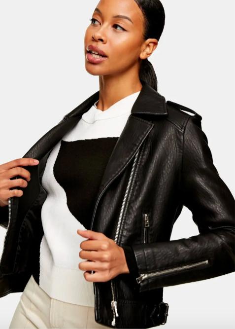 A model wearing the moto jacket in black