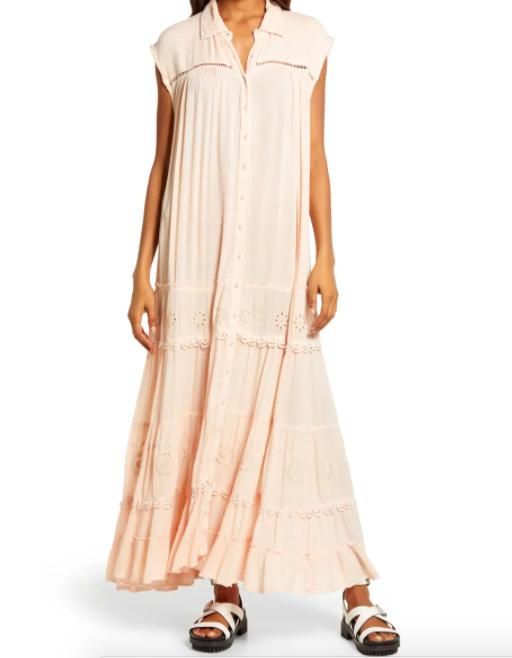 A model wearing the dress in ecru