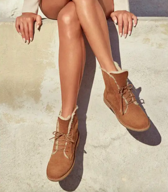 A model wearing the Quincy Boot in chestnut suede