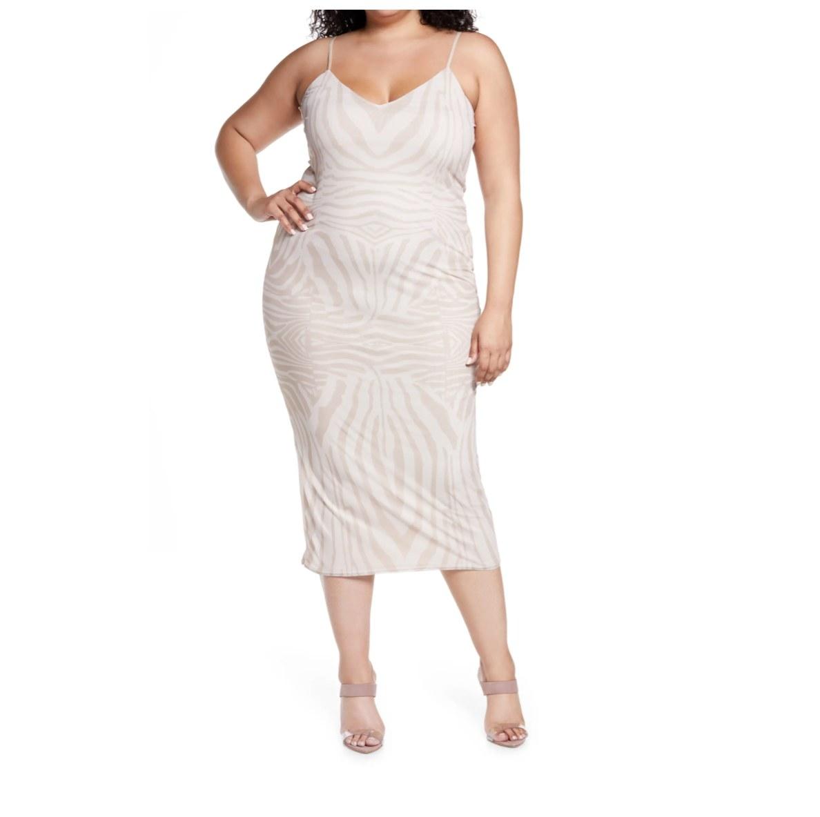 The ivory and beige print midi dress