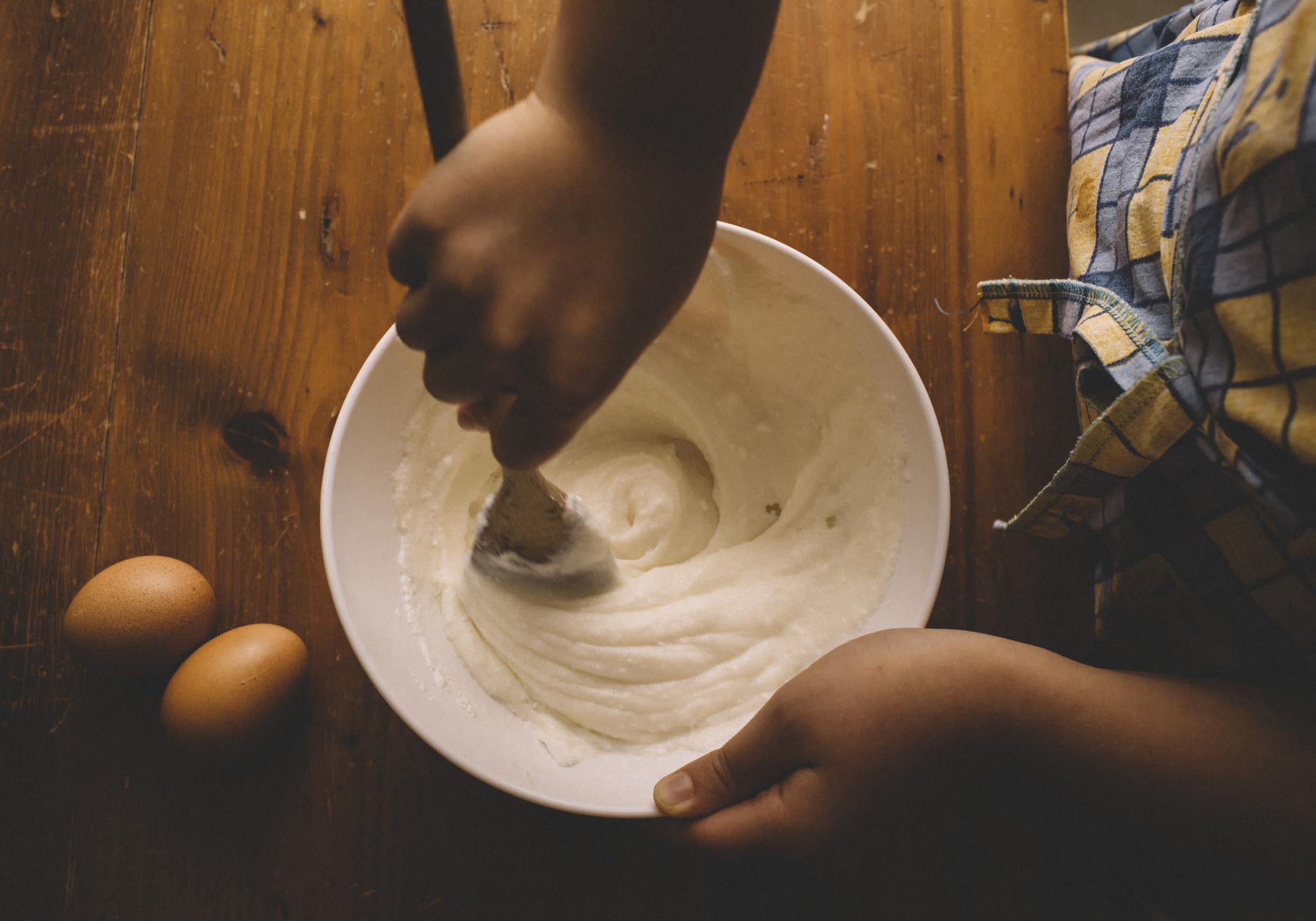 Girl mixing cake batter.