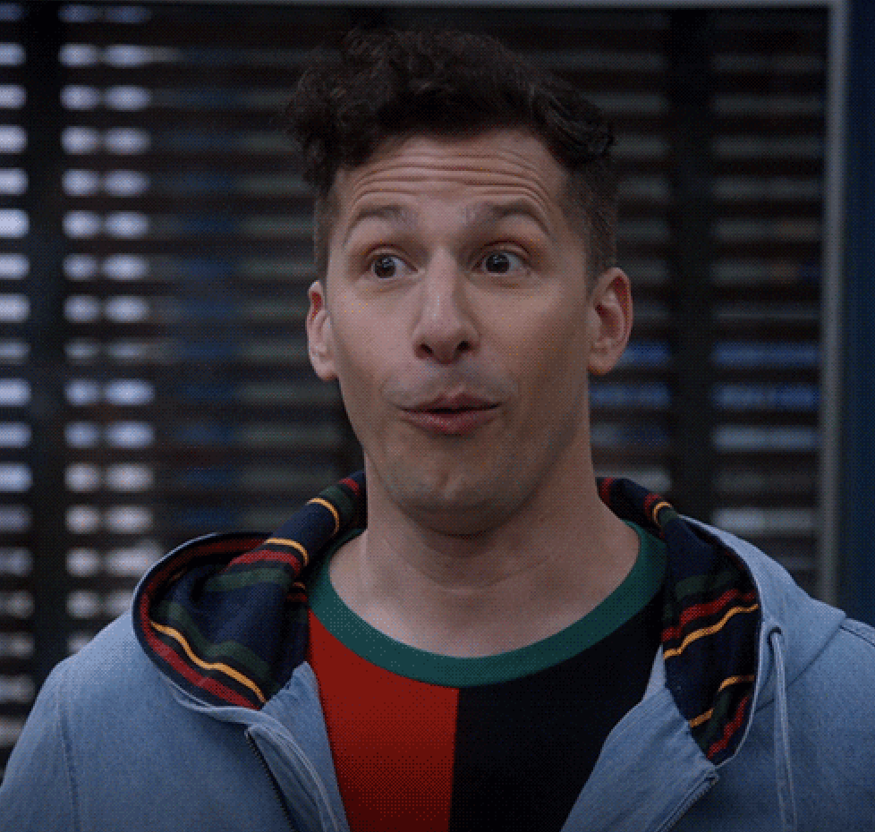 Jake Peralta looking caught off guard and ready to laugh