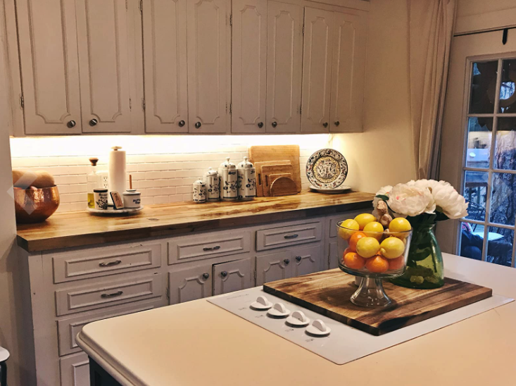 reviewer image of kitchen cabinets with lighting installed underneath