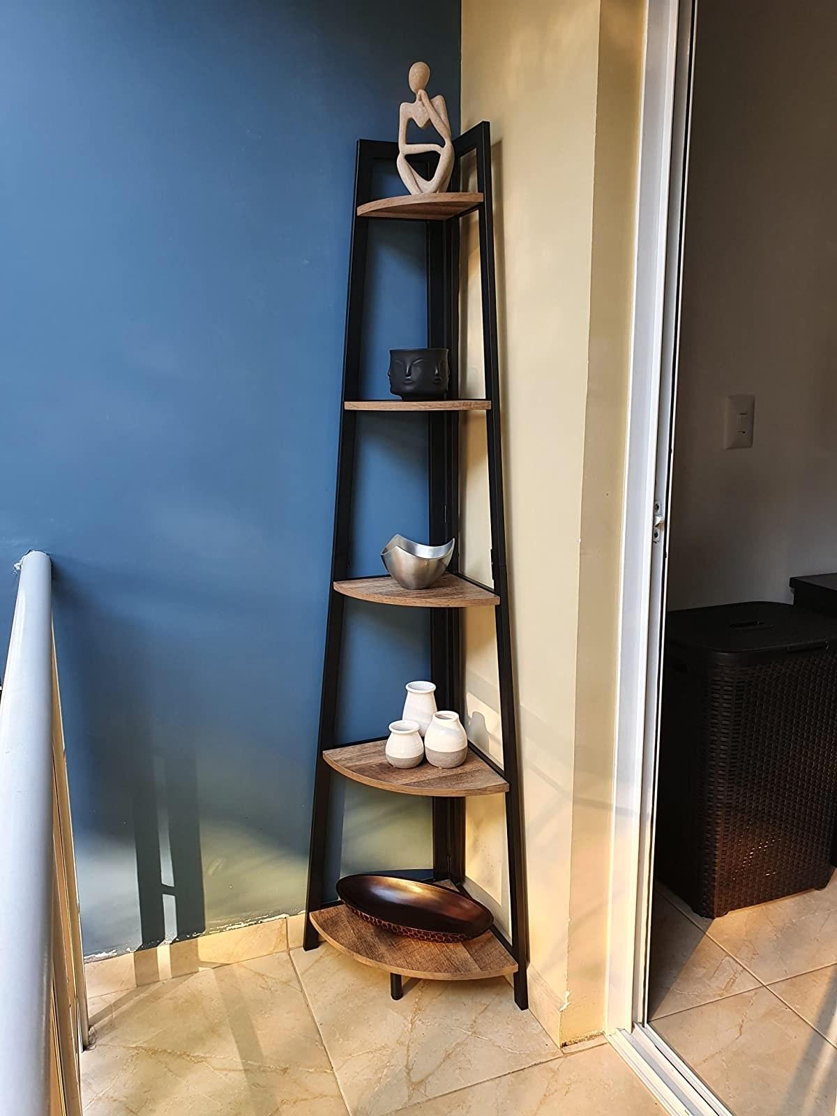 The pyramid-shaped bookshelf in a corner
