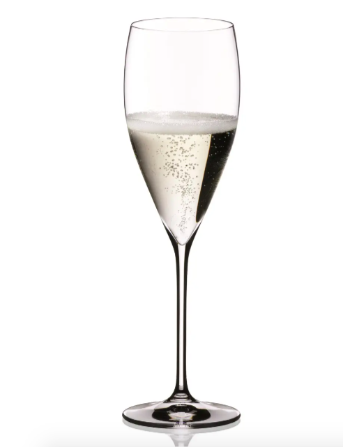 One of the champagne flutes filled with champagne
