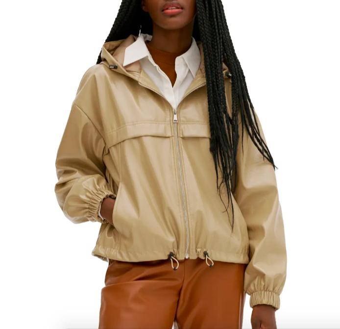 A model wearing the jacket in beige