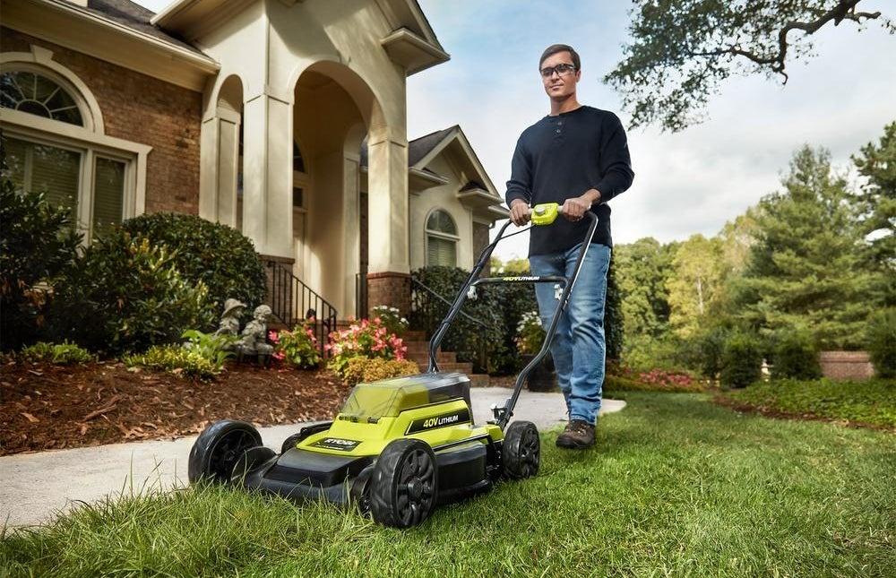 a model pushing a lawn mower