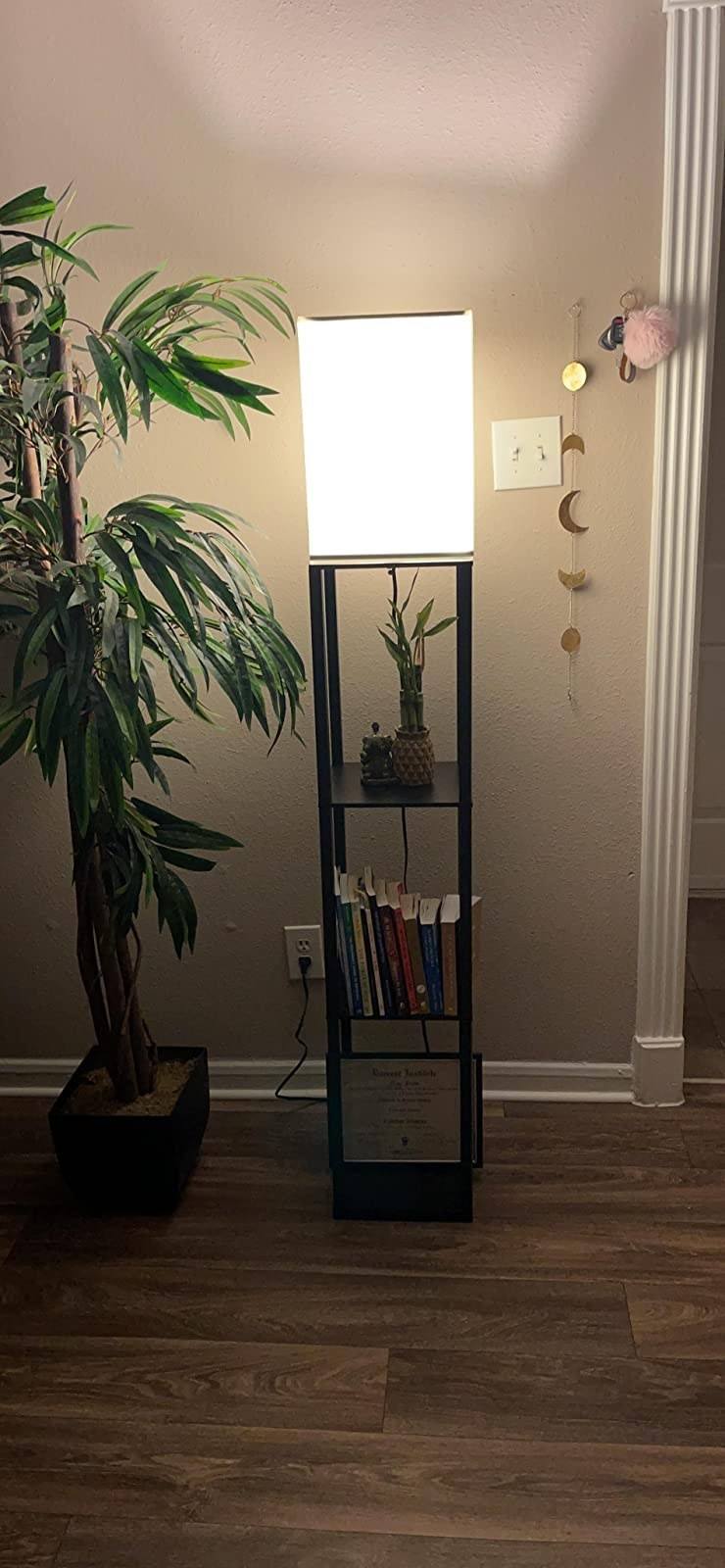 The slim, rectangular-shaped lamp with three shelves underneath the light