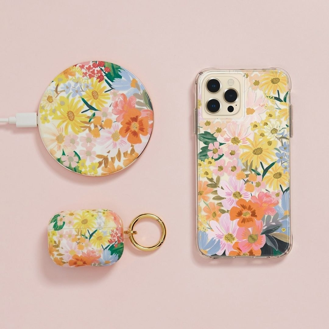 the phone case, charger, and wireless charger in a fun floral pattern
