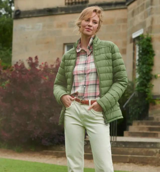 A model wearing the Ashridge Puffer Jacket in bay leaf