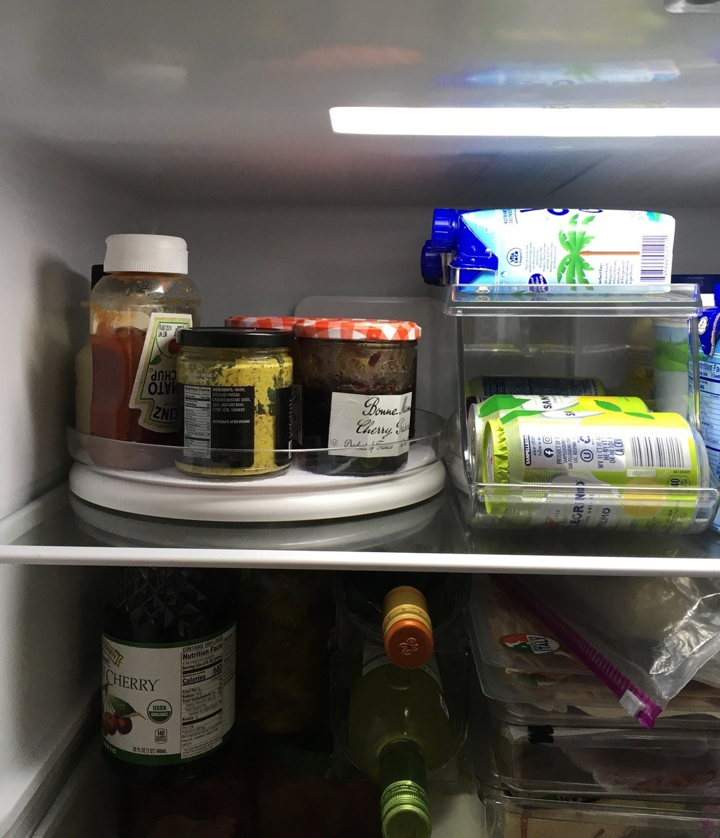 The turntable in a fridge holding several condiments