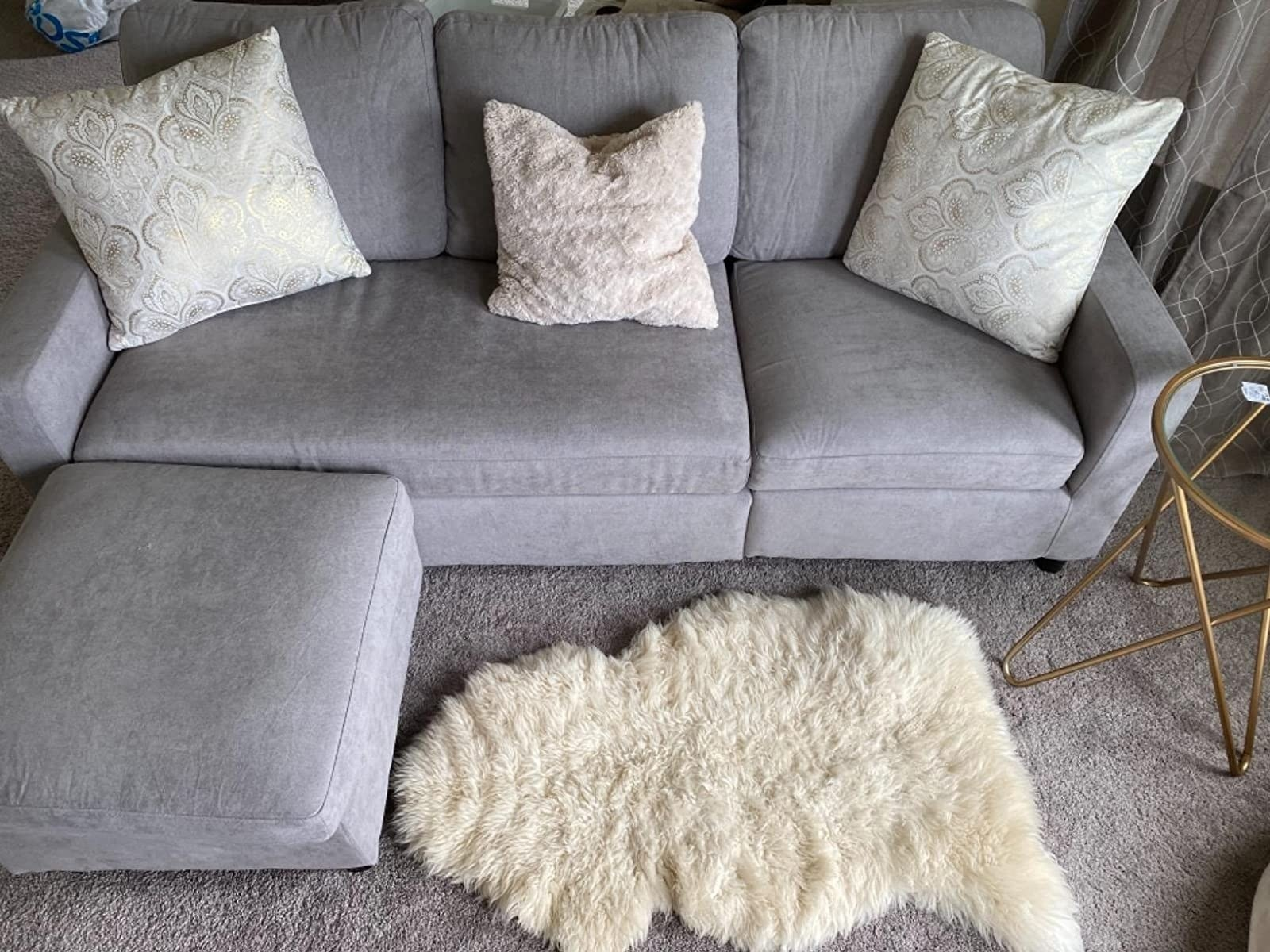 The L-shaped sofa with thick cushions in a living room