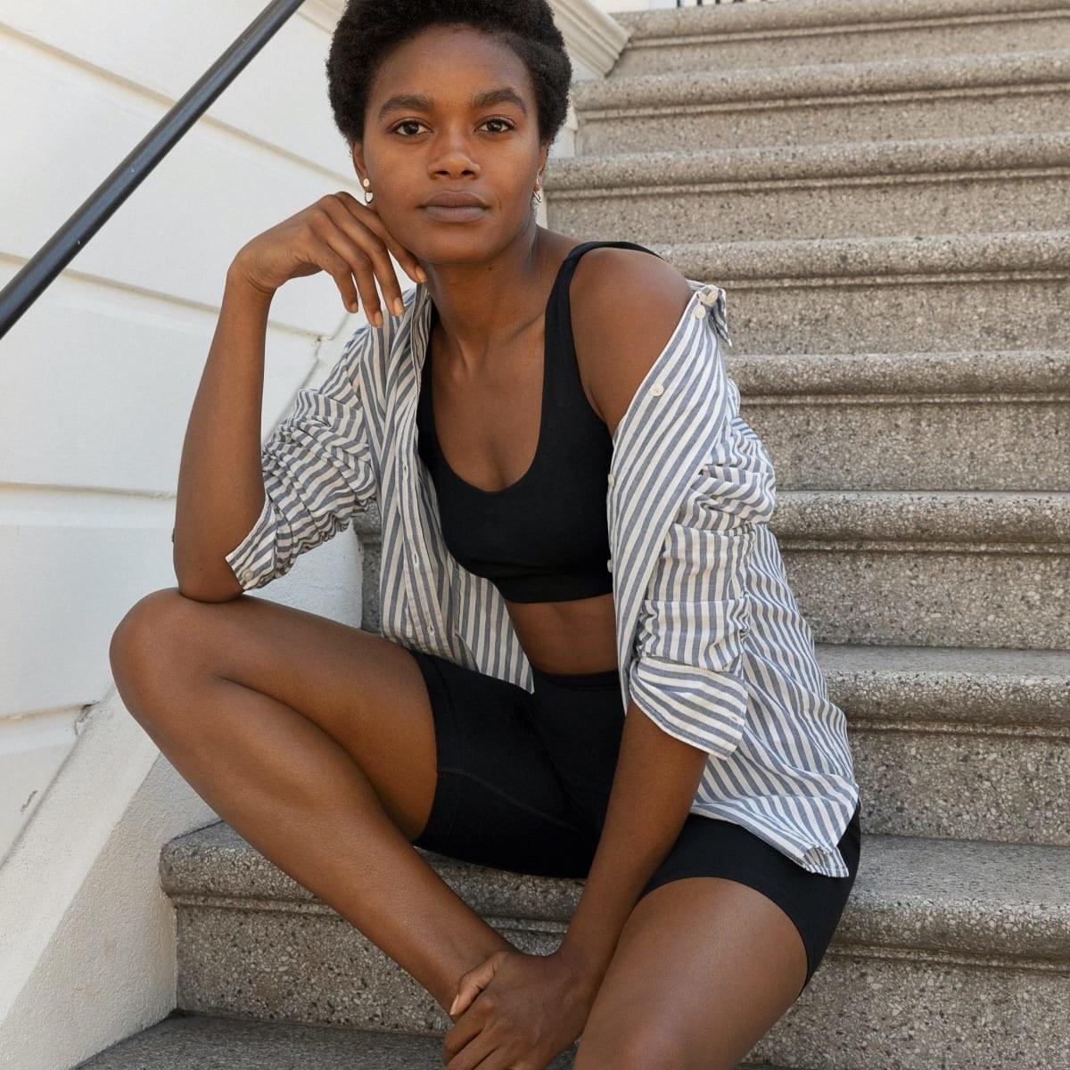 model in black mid-length bike shorts