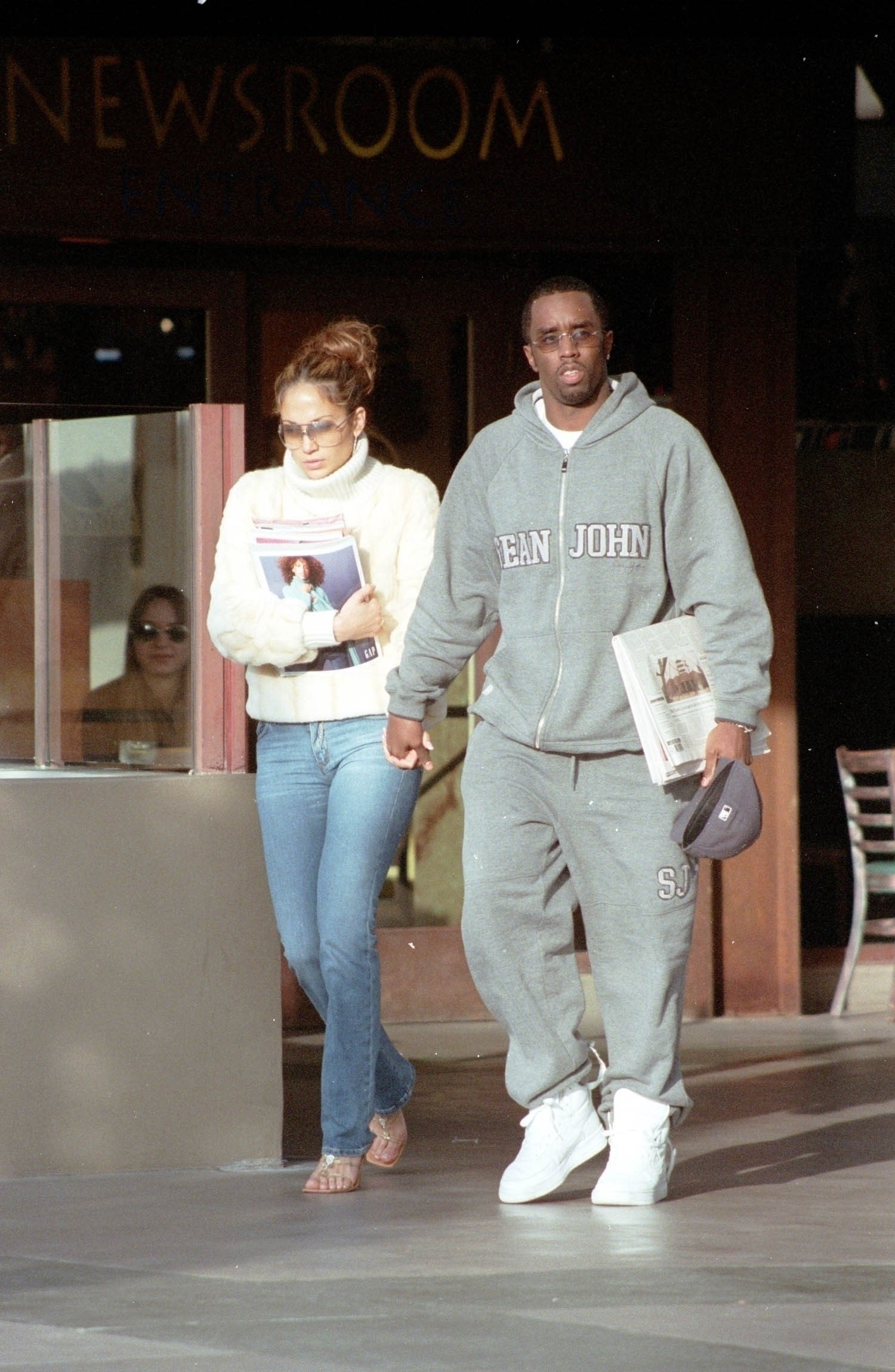 JLo and Diddy holding hands as they walk outside