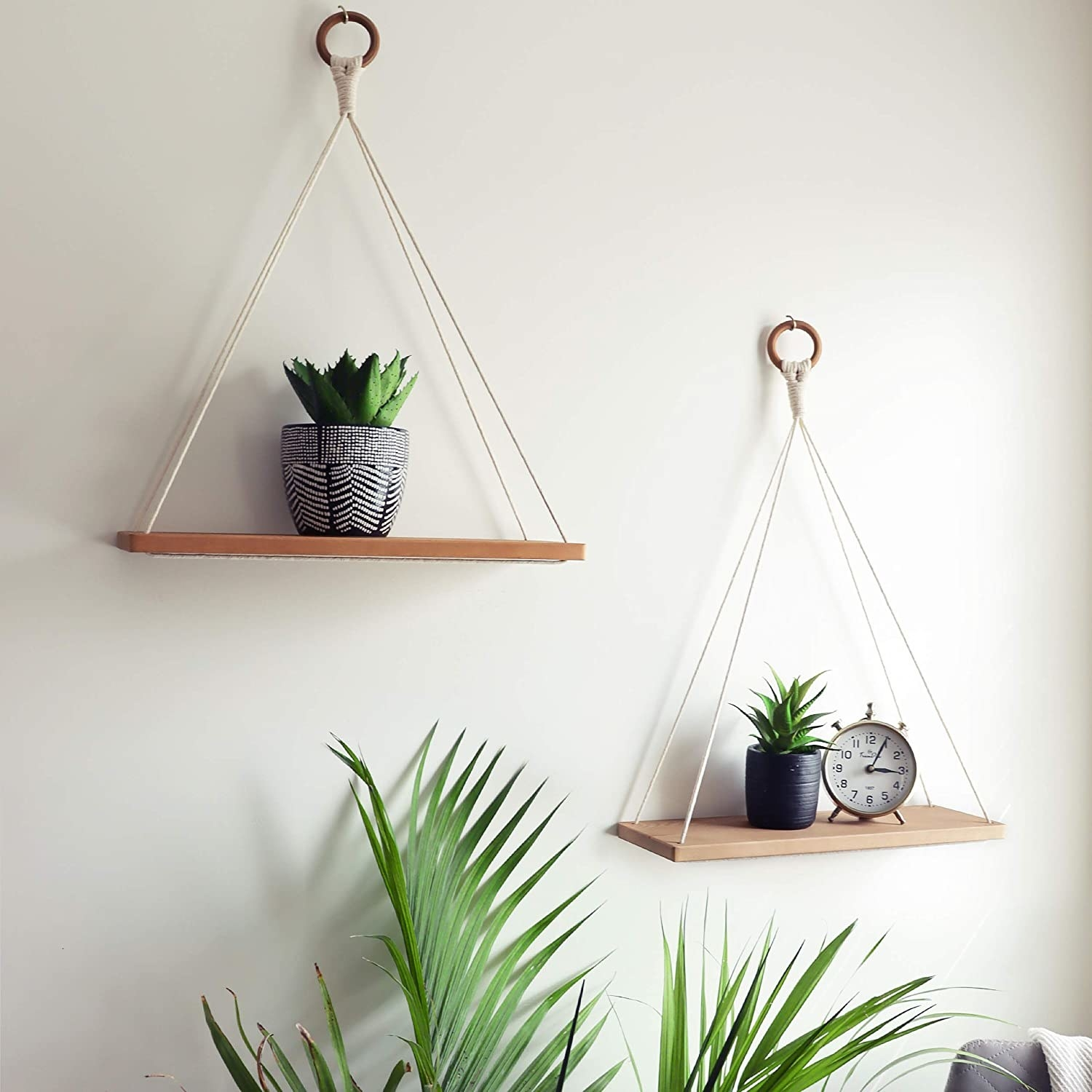 macrame hanging shelves with tiny succulents on wall
