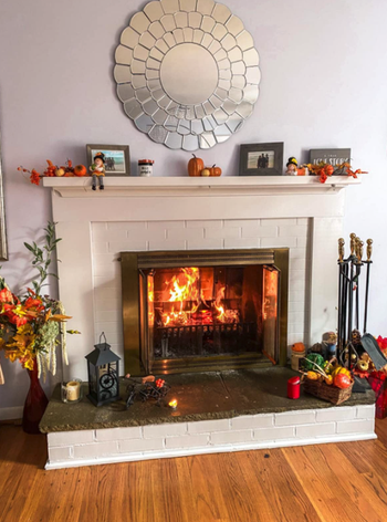 after image of same fireplace with white color that looks totally new and different