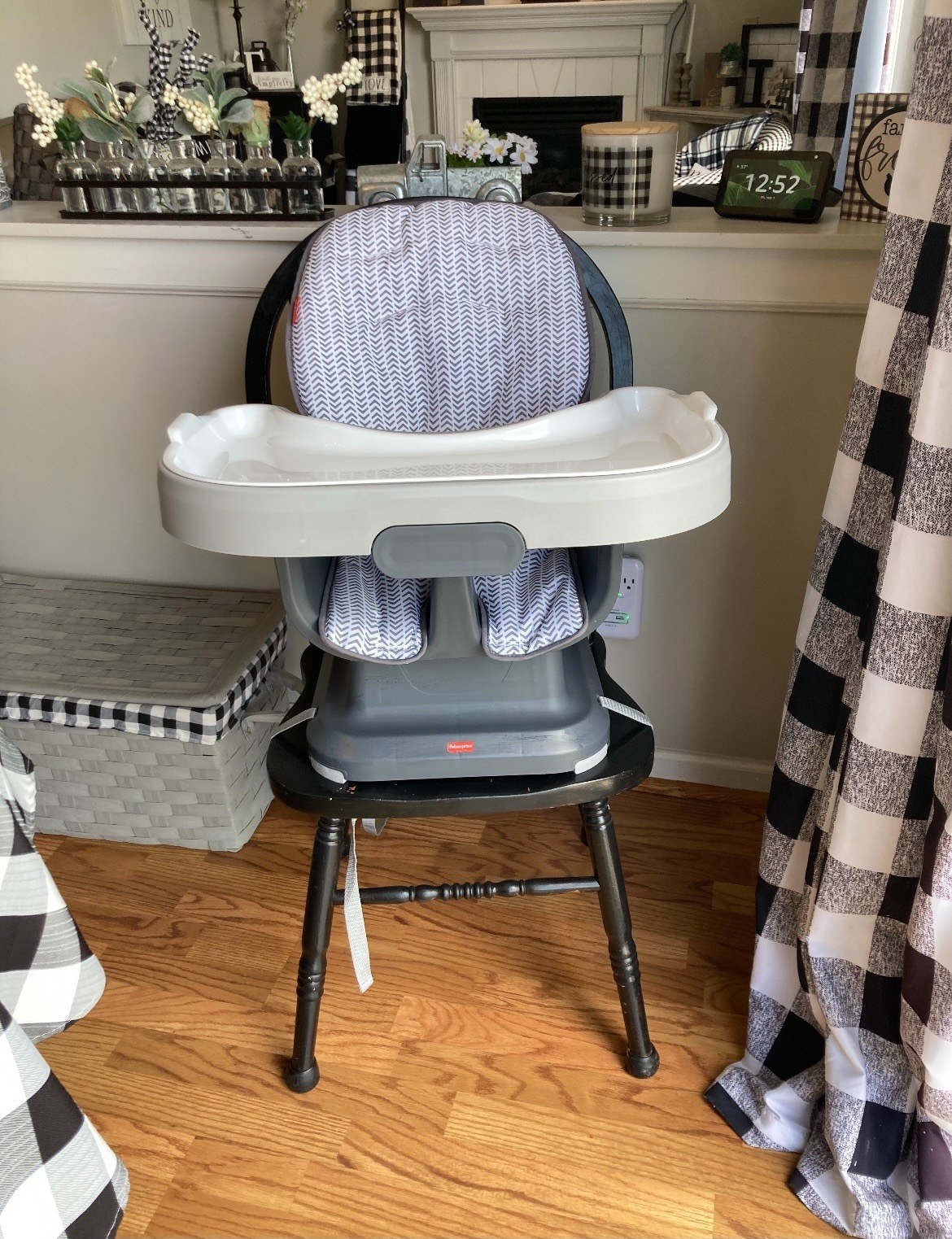 The high chair with a tray fastened to a dining chair