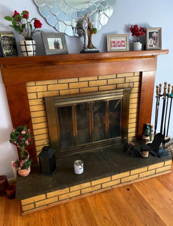 before image of reviewer's fireplace with yellow brick