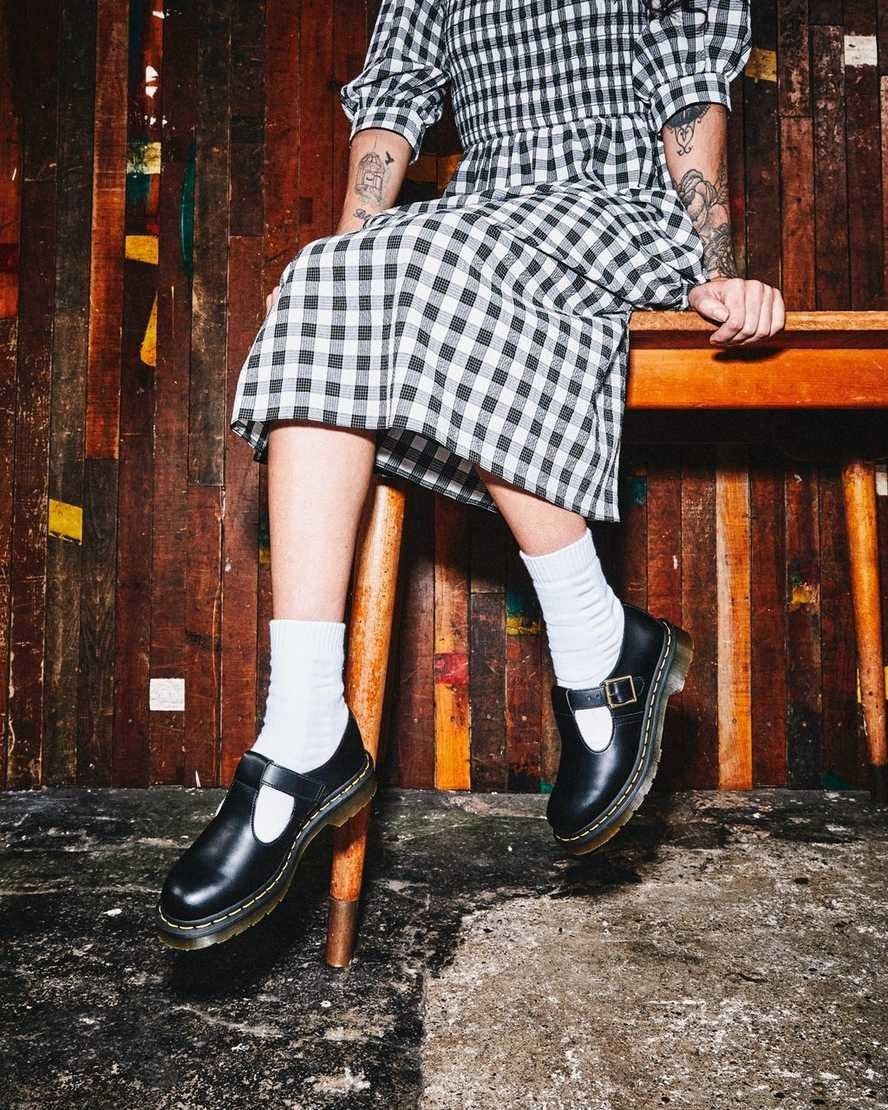 Model's legs with the buckled shoes paired with long white socks