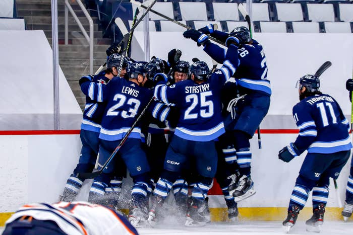 An image of the Winnipeg Jets celebrating their victory.