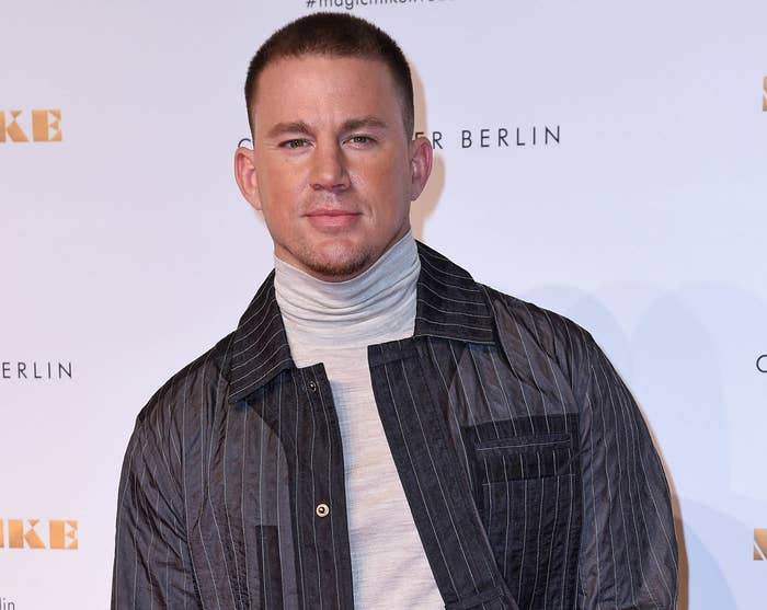 Channing smiles on a red carpet