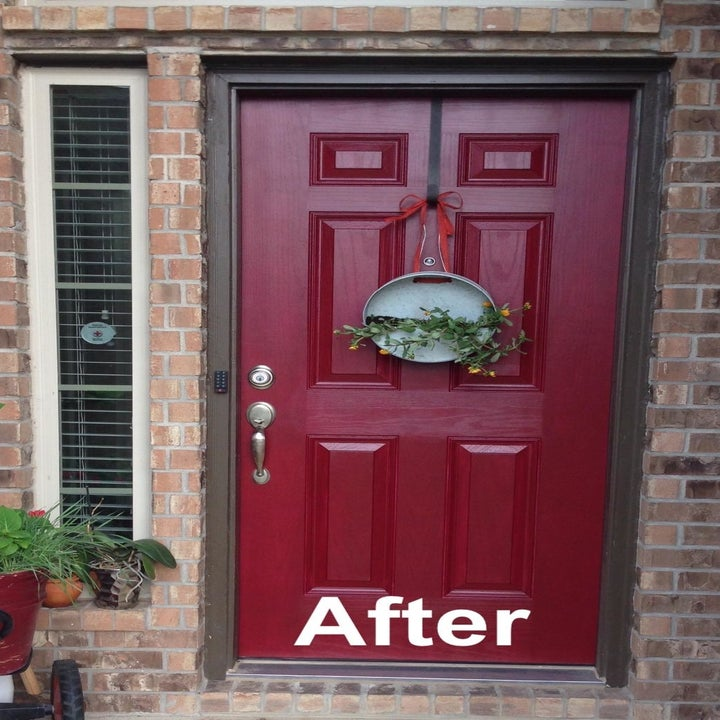"""a reviewer photo of the same door painted red with text reading """"after"""""""