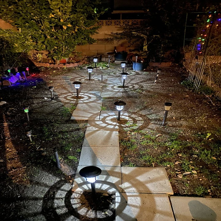 a reviewer photo of a stone path lined with the illuminated stake lights