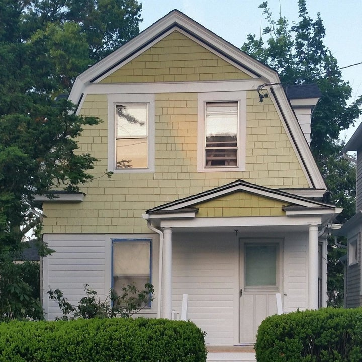 a reviewer photo of a home's exterior without shutters on the window