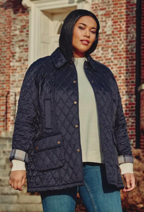 A model wearing the jacket in navy