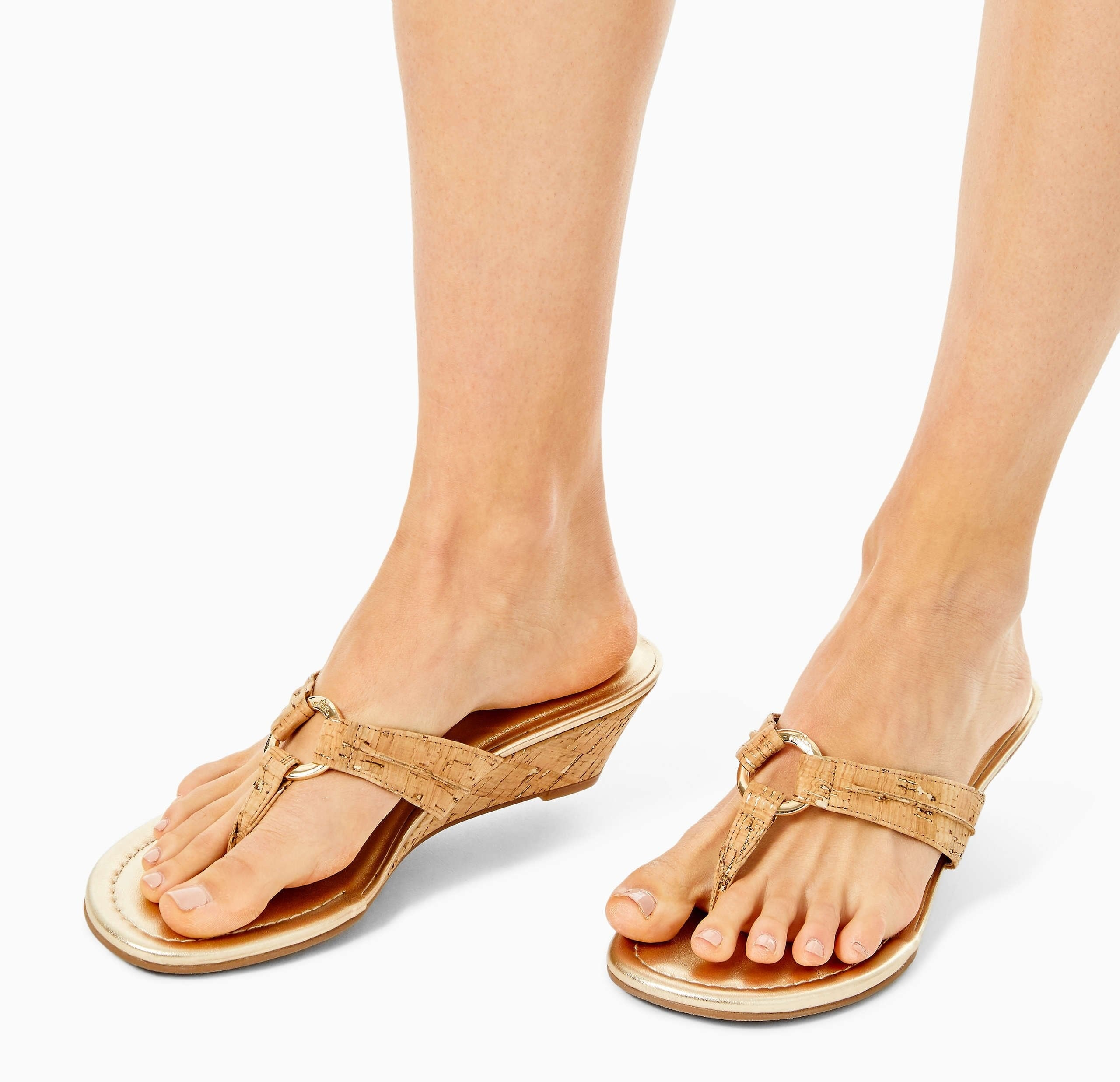 Sand colored wedges with round detail that attaches the straps