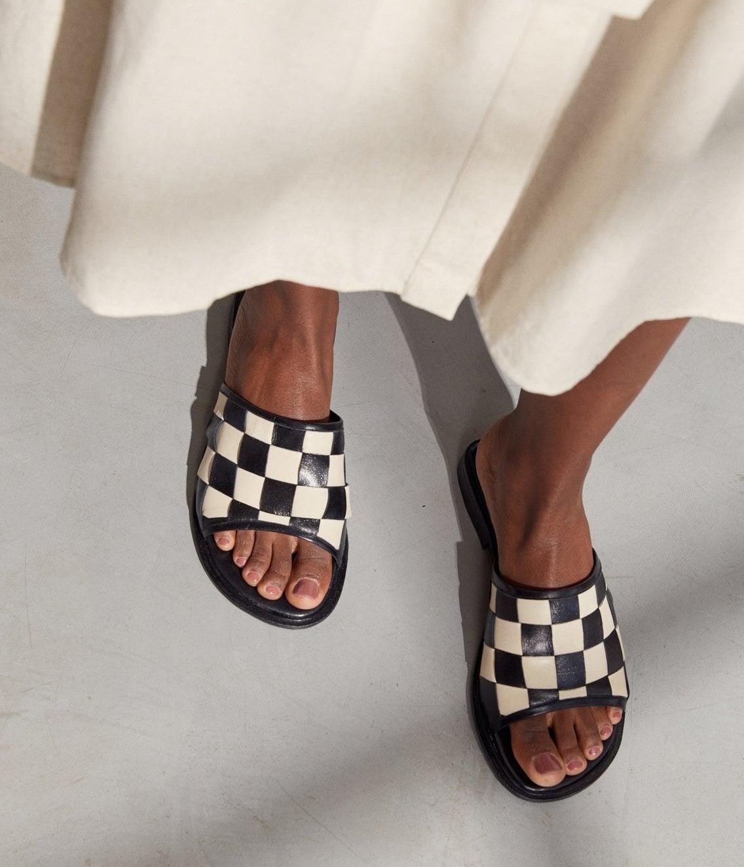 Black and white checkered slide-on flats