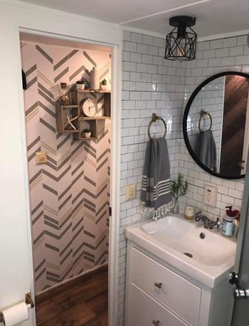 reviewer's RV camper bathroom with tile behind sink vanity