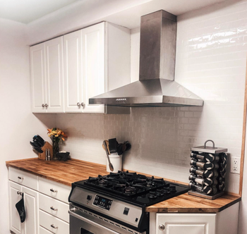 reviewer kitchen with subway wallpaper installed