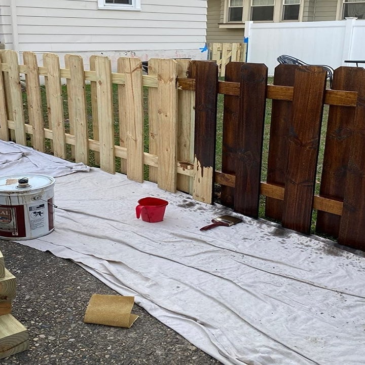 a reviewer image of a fence have light and half stained dark