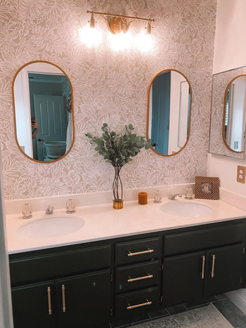 different reviewer's bathroom with black cabinets and gold pulls installed on drawers and cabinets