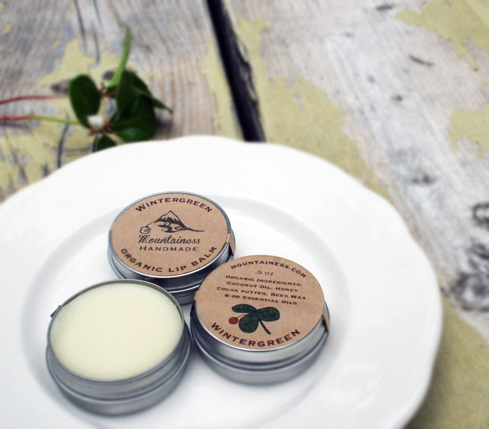 canisters of wintergreen organic lip balm