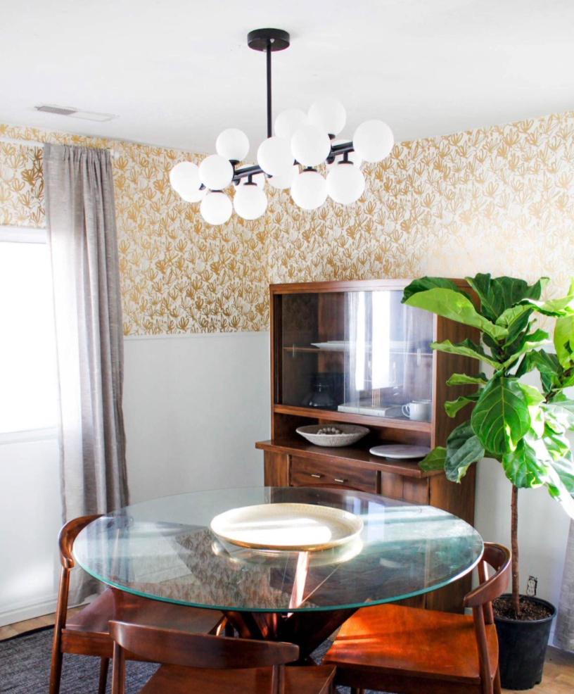 reviewer image of chandelier hung over mid-mod style dining table