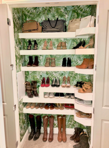 different reviewer's closet with wallpaper hung on the back wall behind each shelf