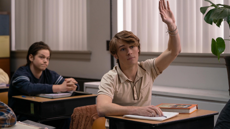 Hunter raises his hand in class