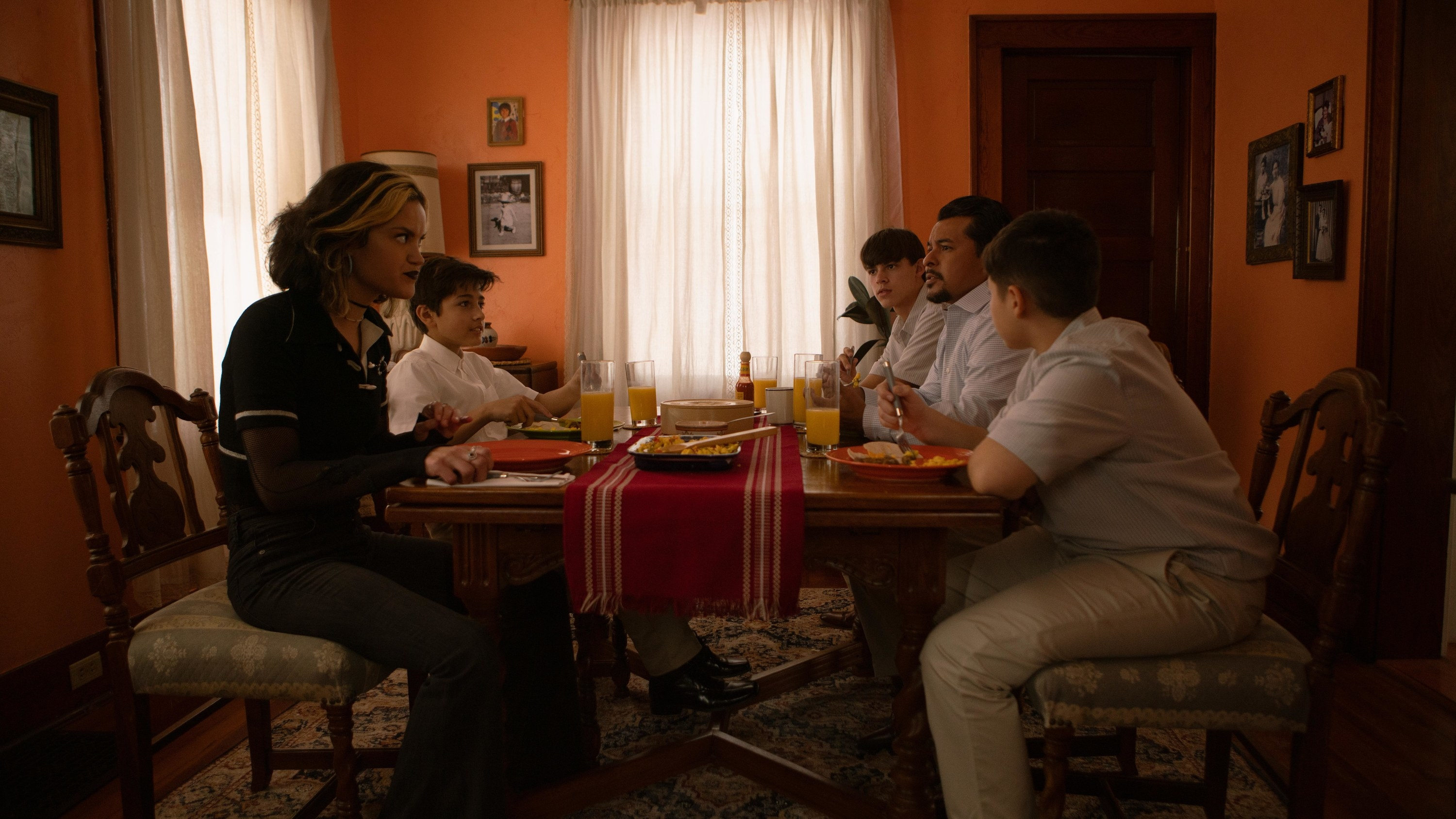 Lupe sits down with her family for breakfast