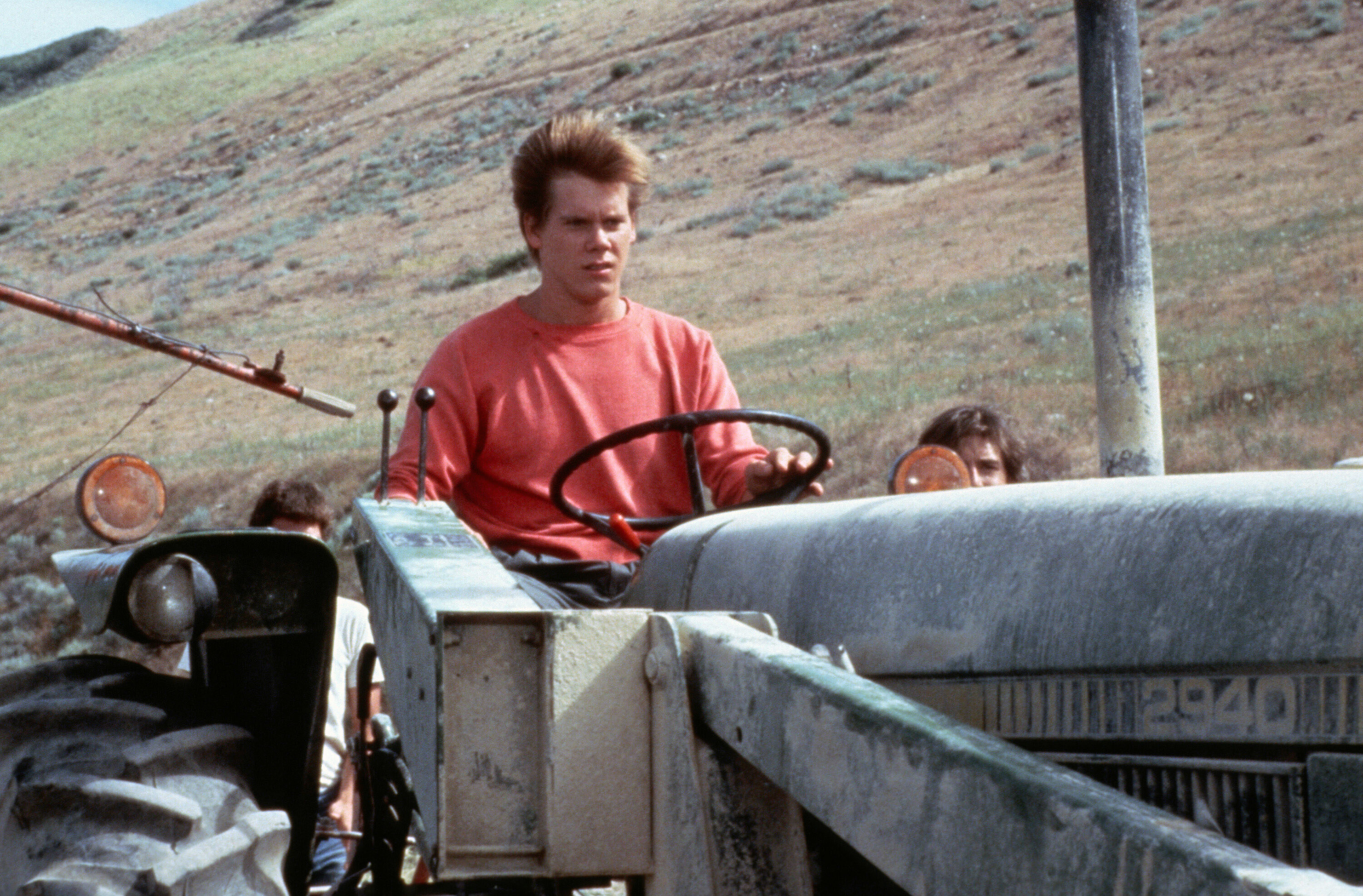 Kevin Bacon on a tractor in the movie Footloose