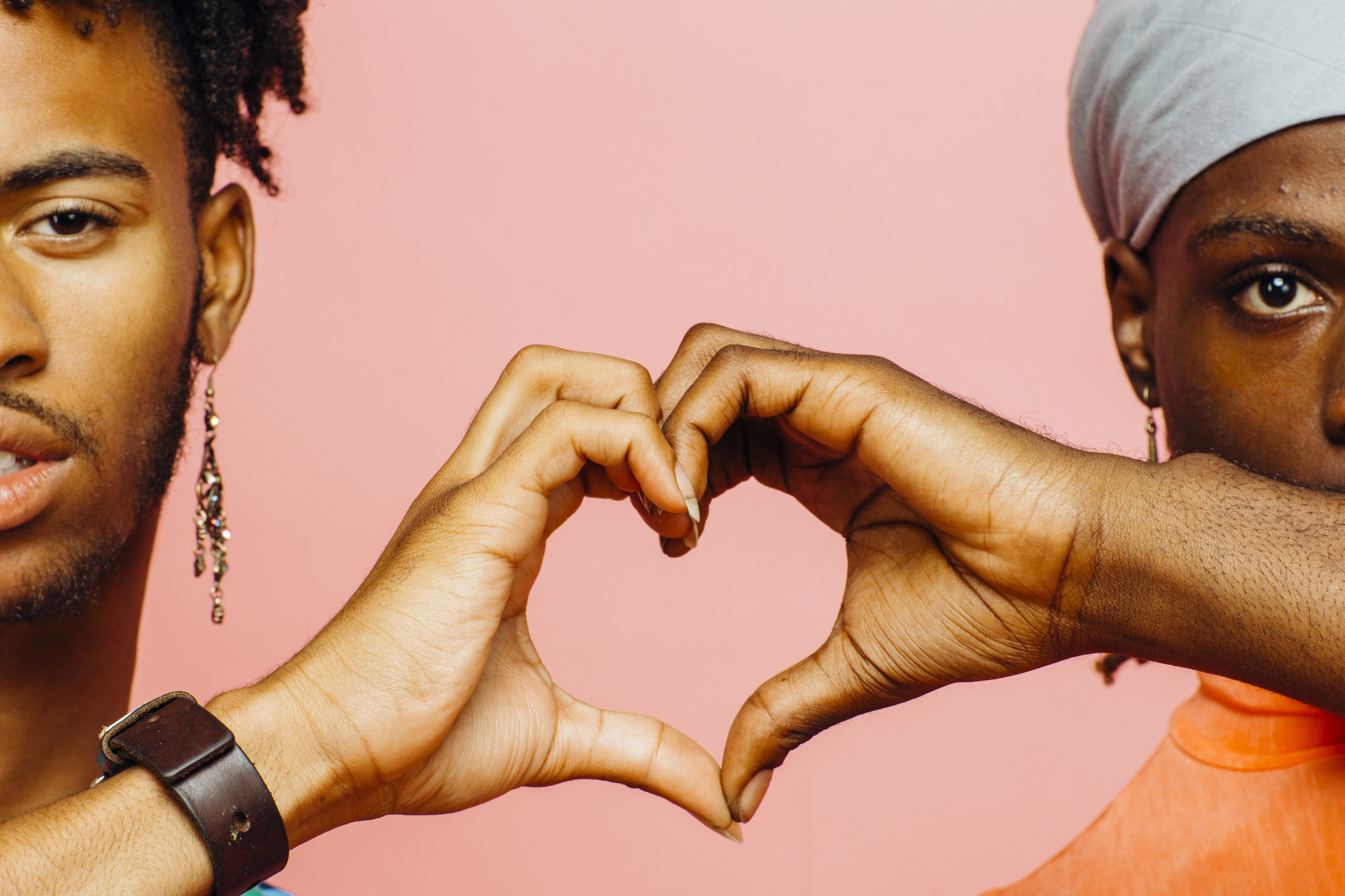 Two young men making a heart with their hands