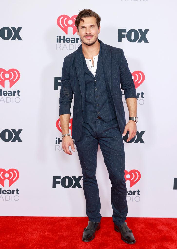 Gleb Savchenko wore a pinstripe suit the 2021 iHeartRadio Music Awards